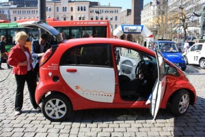 Norway's Finance Minister Krisitn Halvorsen and an electric car. There's a proposal there to ban sales of new gasoline powered cars in Norway starting in 2015.