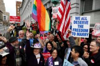 Image: File photo of Gay Marriage advocates cheering during a rally moments before hearing the news of the Proposition 8 over-ruling outside the Ninth Circuit Courthouse in San Francisco
