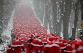 Running of the Santas in Germany......but check out other pictures of Santas hauling ass here. Click image