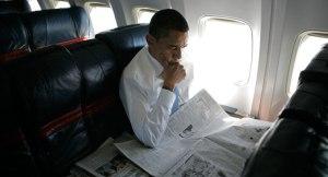 120419_obama_newspapers_ap_605