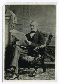 420px-Emerson_reading_newspaper
