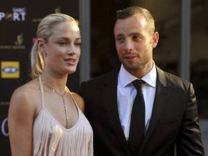 South African Olympic athlete Oscar Pistorius and Reeva Steenkamp attend an awards ceremony in Johannesburg, South Africa last November.(Photo: Lucky Nxumalo, AP)