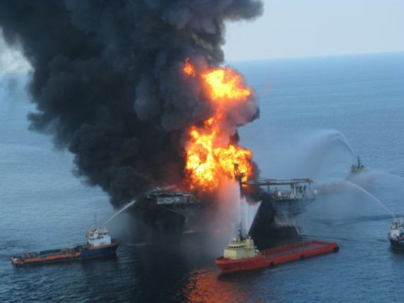 Fire boat response crews battle the blazing remnants of the off shore oil rig Deepwater Horizon on April 21, 2010. The blowout in the Gulf of Mexico killed 11 people and sent 4.9 million barrels of oil gushing from the sea floor into the Gulf (Houston Chronicle).