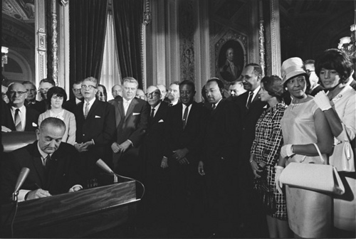 President Lyndon Johnson signs the Voting Rights Act, 1965