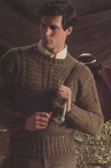Brown modelling a sweater back in the day