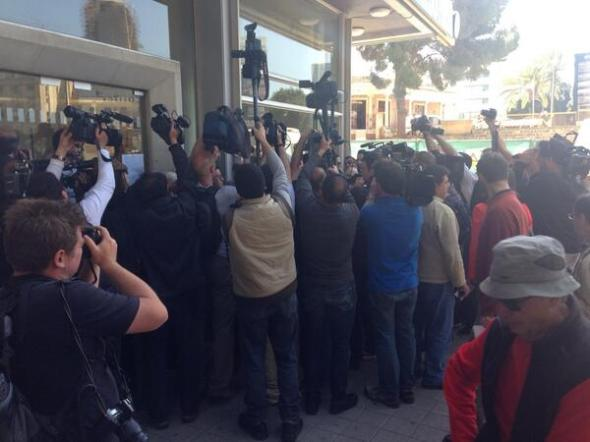 Banks reopen in Cyprus and media jostle to get the best view - posted by Joe Parkinson (@JoeWSJ)