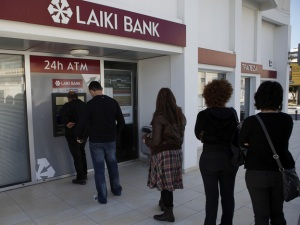 Lines formed at ATMs in Cyprus after news of bank levy broke