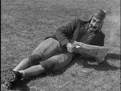 groucho reading newspaper