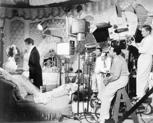 Set photograph, George Cukor directing Robert Taylor and Greta Garbor. 1936