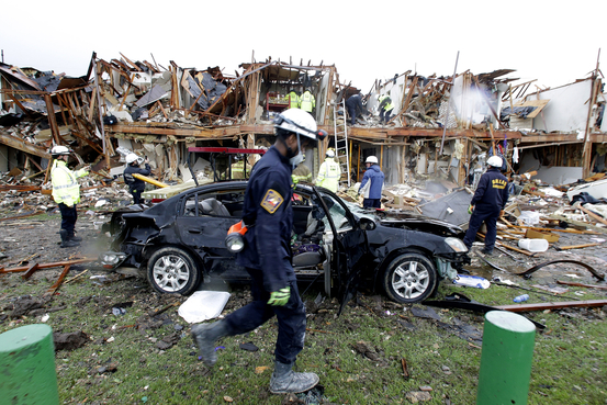 Firefighter conduct search and rescue of an apartment destroyed by an explosion at a fertilizer plant in West, Texas, Thursday, April 18, 2013.