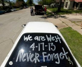 A sign is seen on a car window as residents wait to enter a damaged neighborhood Saturday, April 20, 2013, three days after an explosion at a fertilizer plant in West, Texas (Houston Chronicle)