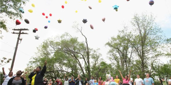 People gather to remember Michelle Knight and release balloons in her honor in a field on Scranton Ave. at Mentor St. on Thurs, May 8, 2013. (Thomas Ondrey/The Plain Dealer)
