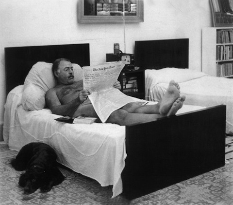 Ernest Hemingway reading The New York Times (naked)