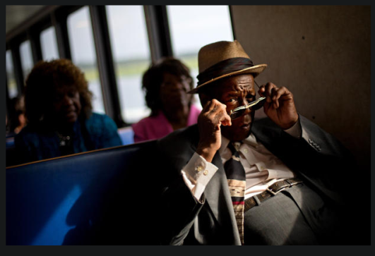 Georgia's dwindling Geechee community Eddie Wilson, 65, puts on his glasses while riding the ferry from the mainland to attend a church service for the 129th anniversary of St. Luke Baptist Church on Sapelo Island, June 9, 2013.