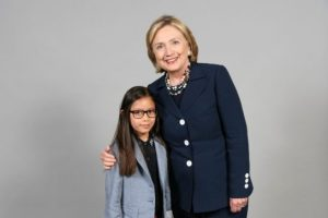 Former U.S. secretary of state Hillary Clinton poses with Jaden Szigeti, 9, for a snapshot before speaking to 5,000 at the Metro Convention Centre. (Toronto Star)