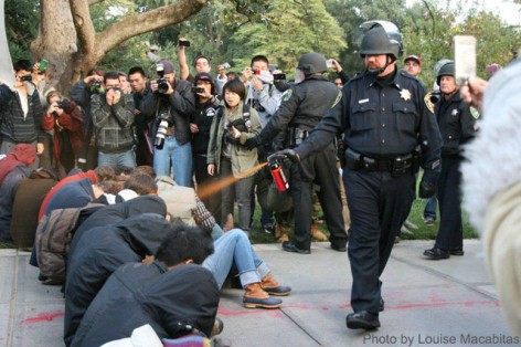 UC Davis Police Officer Lt. John Pike pepper sprays Occupy demonstrators.