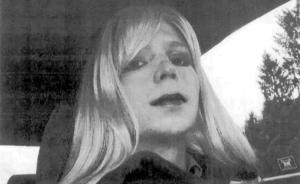 This undated photo provided by the U.S. Army shows Pfc. Bradley Manning posing in a wig and lipstick.