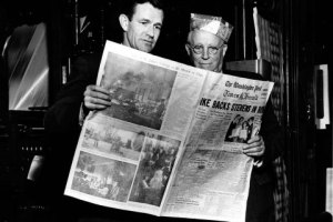Philip L. Graham and Eugene Meyer look at the first The Washington Post Times Herald, in Washington, March 18, 1954.