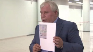 Lawyer Anatoly Kucherena holds Edward Snowden's entry papers from Russian Immigration Service