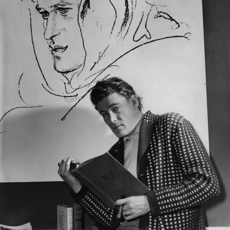 Irish actor Peter O'Toole studying for his role in Lawrence of Arabia.