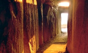 Sun coming up the passage during the winter solstice at Newgrange Tomb. Photograph: National Monuments Service