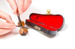 a09bc_worlds-smallest-violin