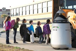 The K5 robot outside a school