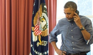 US President Barack Obama talks with Russian President Vladimir Putin on the phone