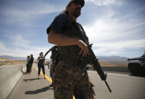Armed supporters of Cliven Bundy wield weapons against Federal agents.