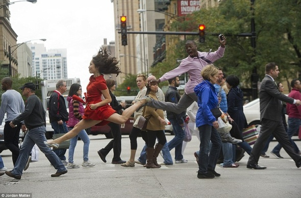 Dancer Crossing In Chicago, Angela Dice and Demetrius McClendon leap among pedestrians at a street crossing. Photo by Jordon