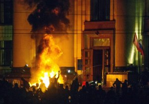 Pro-Russia protesters burn tires near a regional administration building in Kharkiv in a back-and-forth clash with riot police for control of the building. (Oleg Shishkov, EPA / April 7, 2014)