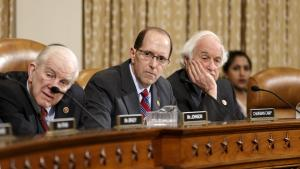 House Ways and Means Committee Chairman Rep. Dave Camp, R-Mich. (center), flanked by the committee's ranking member, Sander Levin, D-Mich. (right), and Sam Johnson, R-Texas.