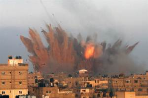 Smoke and fire rise above the skyline following an Israeli air strike on July 11 in Rafah in the southern Gaza Strip. Israeli warplanes kept up deadly raids on Gaza Friday but failed to stop Palestinian militants firing rockets across the border (NBC News).