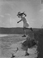 unidentified small girl leaping onto the beach, c. 1930s, by Sam Hood by State Library of New South Wales collection