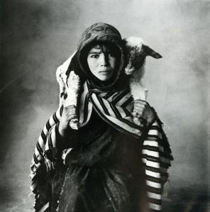 Irving Penn - A young Berber shepherdess of the Aït Yazza people in the High Atlas, with a newborn lamb.