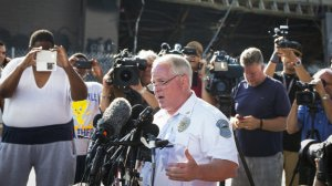 Ferguson Police Chief Thomas Jackson announces the name of Officer Darren Wilson as the man who shot and killed Michael Brown, 18, last Saturday.