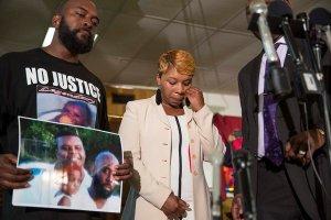 Michael Brown Sr. and Lesley McSpadden, while mourning their son, asked supporters to remain peaceful. Credit Whitney Curtis for The New York Times