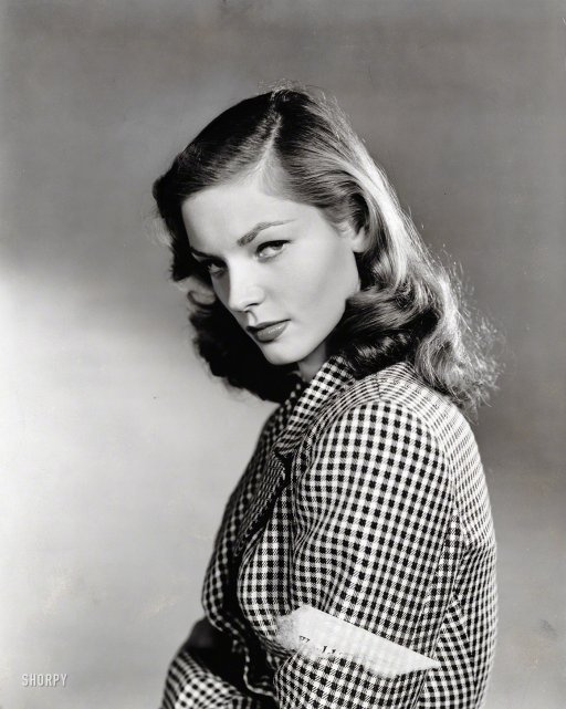 "Lauren Bacall, the smoky-voiced movie legend who taught Humphrey Bogart how to whistle in ""To Have and Have Not,"" died today in New York at the age of 89.     -- Los Angeles Times 1944. ""Lauren Bacall in checkered jacket."" Publicity shot from the New York World-Telegram / The Sun Newspaper Photograph Collection."