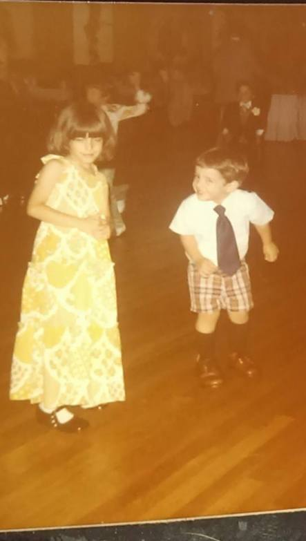 Me and my cousin David at a family wedding...I'm around 4 years old, and in the back of the photo...a midget in a tux with a flower in the lapel.
