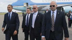 Secret Service agents with President Obama on his arrival in Columbia in 2012