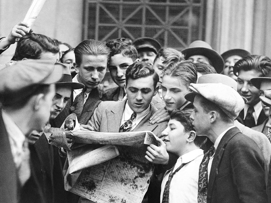 Crowds Of People Clustered In The Streets Reading News