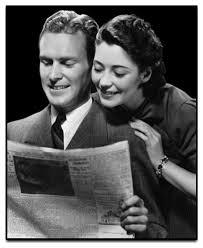 man and woman newspaper