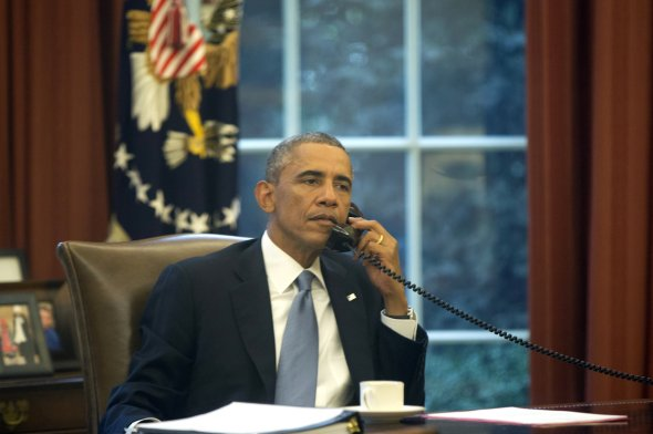 In this image made through a window of the Oval Office, President Obama speaks on the phone to Saudi Arabia's King Abdullah on Wednesday (NPR)