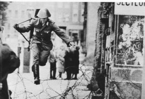 1961, Conrad Schumann became one of the most famous defectors from East Germany. Schumann was a 19 year old soldier on duty guarding the construction of the Berlin Wall.