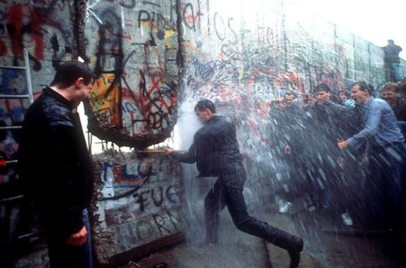 The Wall Comes Down A West Berliner soaked by a water cannon takes a sledgehammer to the wall on November 11, 1989.