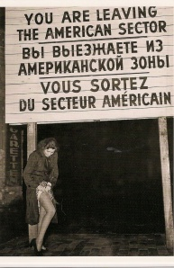 Postcard from Berlin. A woman hiding her Deutsch Marks at Checkpoint Charlie on July 11, 1948.