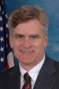 Bill Cassidy tries to smile and fails miserably.