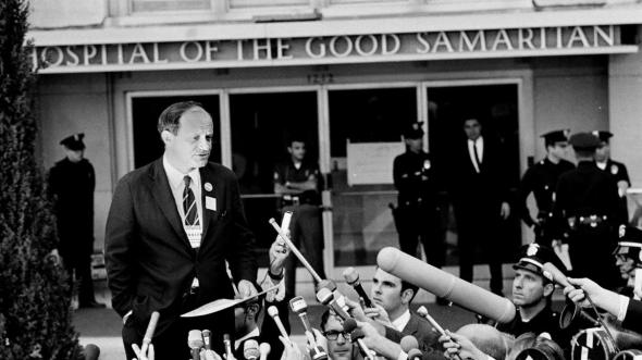 Frank Mankiewicz speaking to reporters about Bobby Kennedy's condition, 1968.