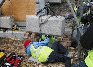 Massachusetts officials worked to remove a time capsule in the cornerstone of the State House in Boston, on Dec. 11, 2014 (h/t The Boston Globe).