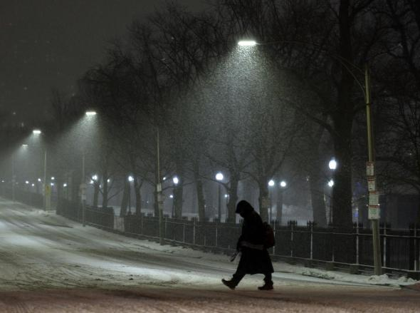 A pedestrian crosses Beacon Street in Boston as a large snowstorm approaches New England on Monday, January 26, 2015. Staff photo by Christopher Evans